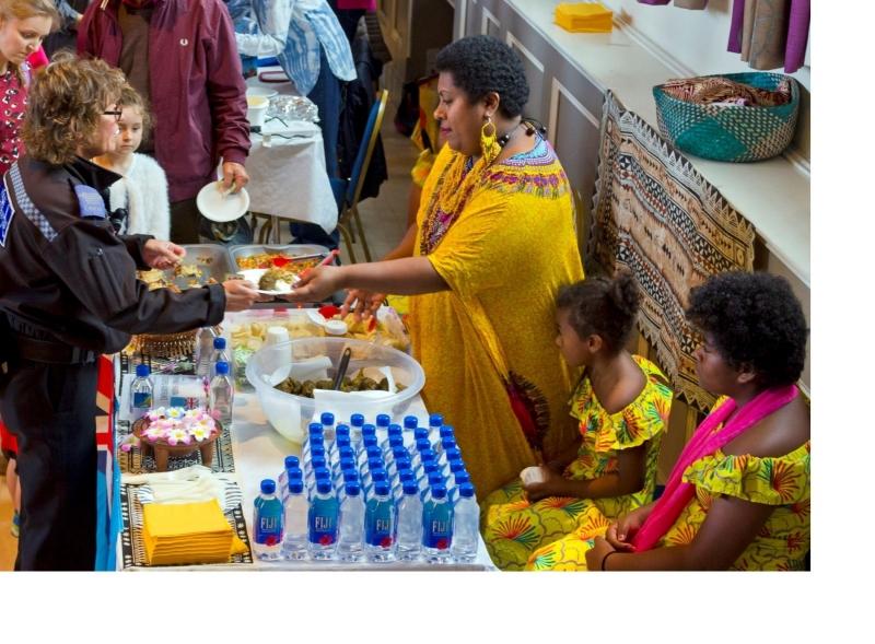 Fijian food stallholder serving communit police officer in Devizes Corn Exchange