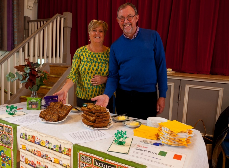 Irish food stall - couple with cake adnd shamrocks on table at Devizes Corn Exchange