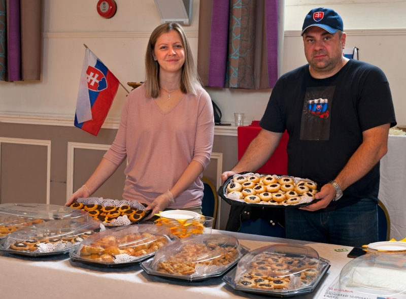 Slovakian food stallholders with pastries in Devizes Corn Exchange