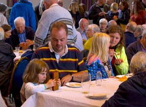 Family eating at a table during World Food Day at Devizes Corn Exchange